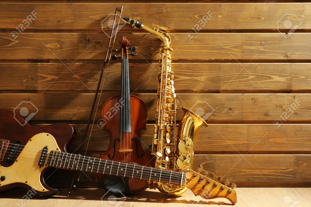Musical instruments on wooden background - 94540927