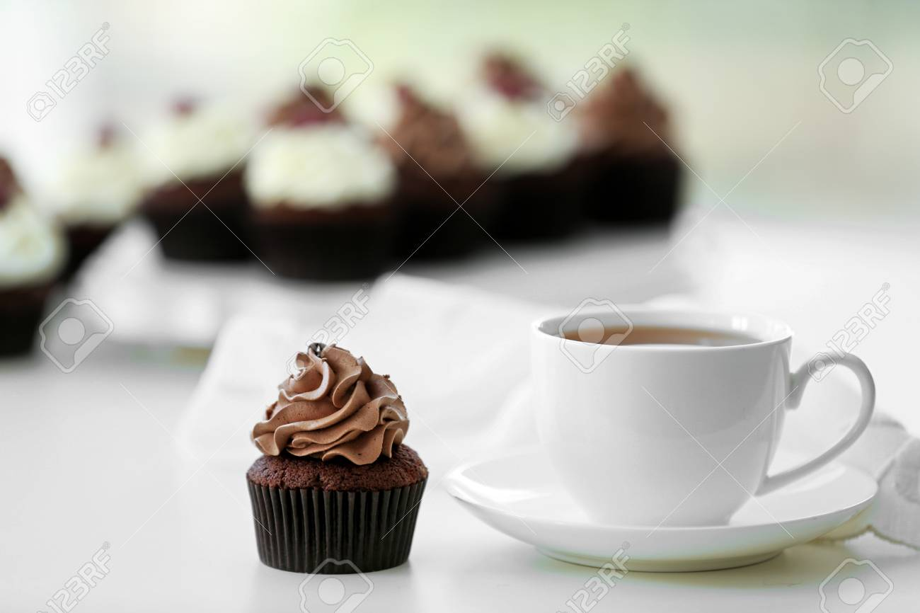 Beautiful Chocolate Cupcakes And Cup Of Tea On Table Stock Photo