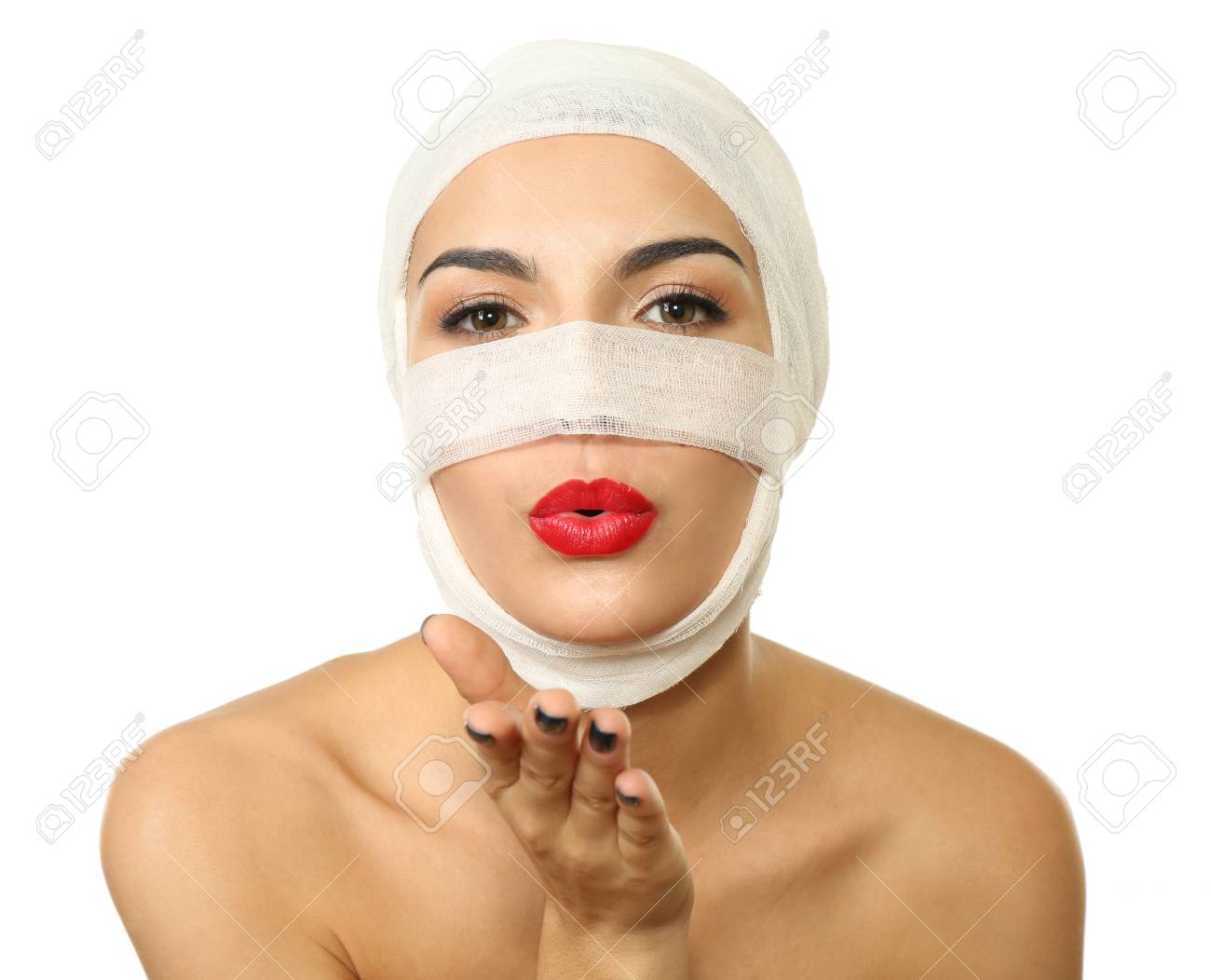 Young beautiful woman with a gauze bandage on her head and nose,