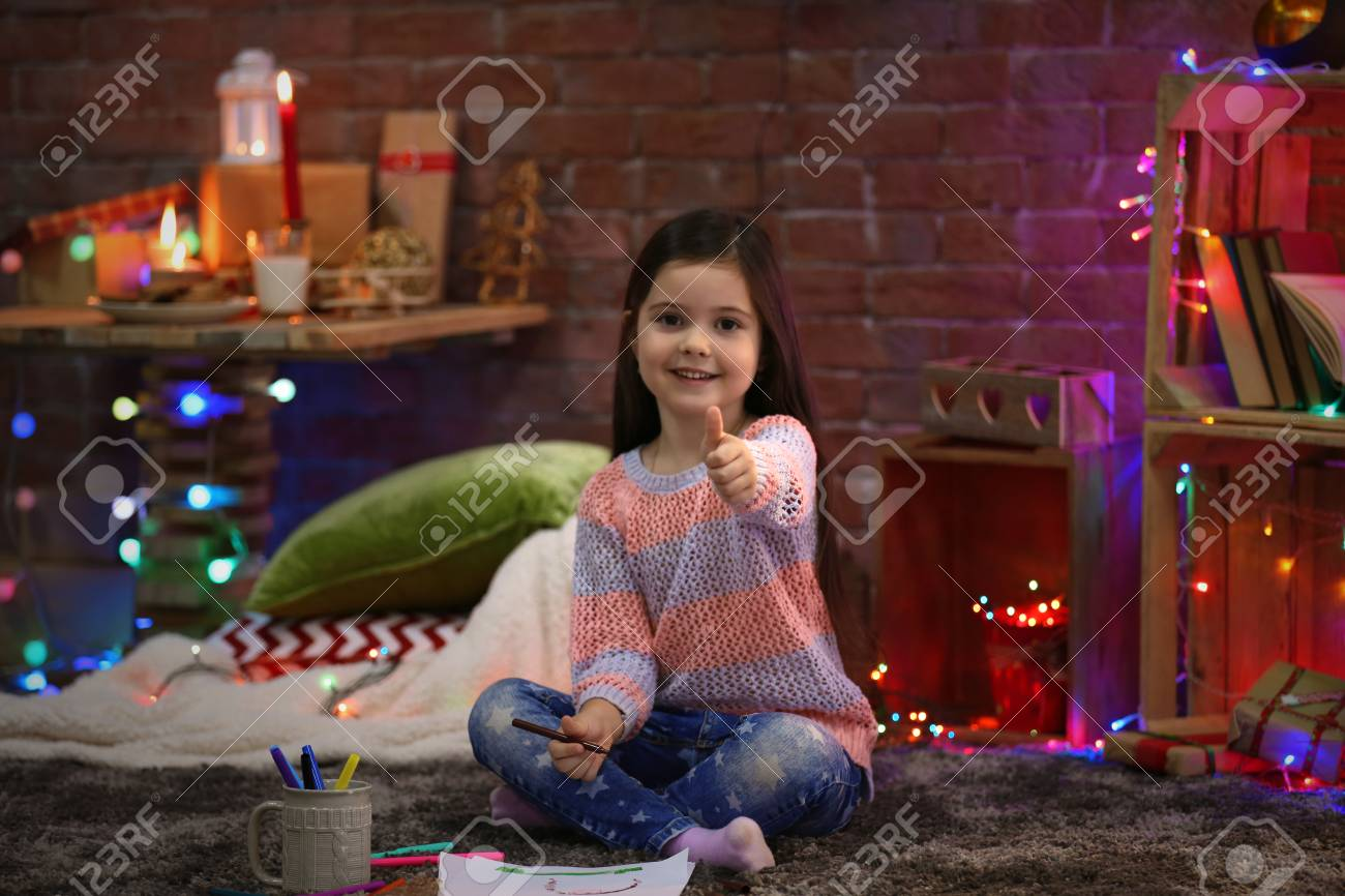 Pretty Little Girl Painting In Christmas Decorated Room Stock Photo Picture And Royalty Free Image 95834532