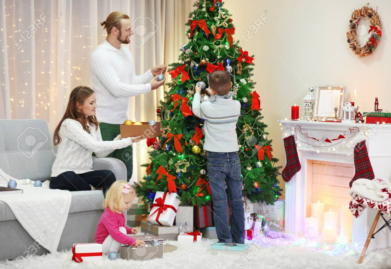 Holiday Living Christmas Tree.Family Decorating Christmas Tree In Home Holiday Living Room