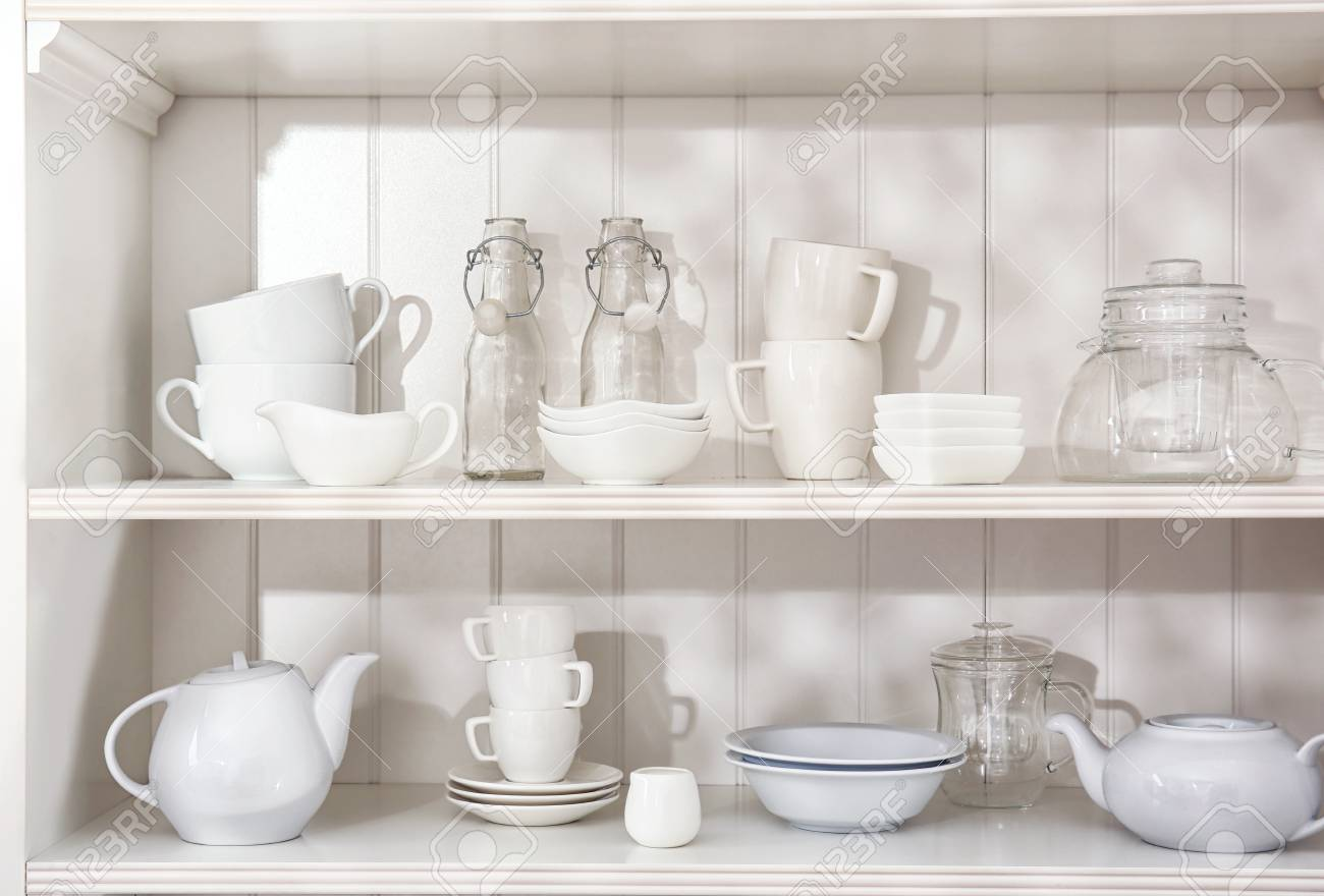 Dishes In Cupboard In The Kitchen Stock Photo, Picture And Royalty ...