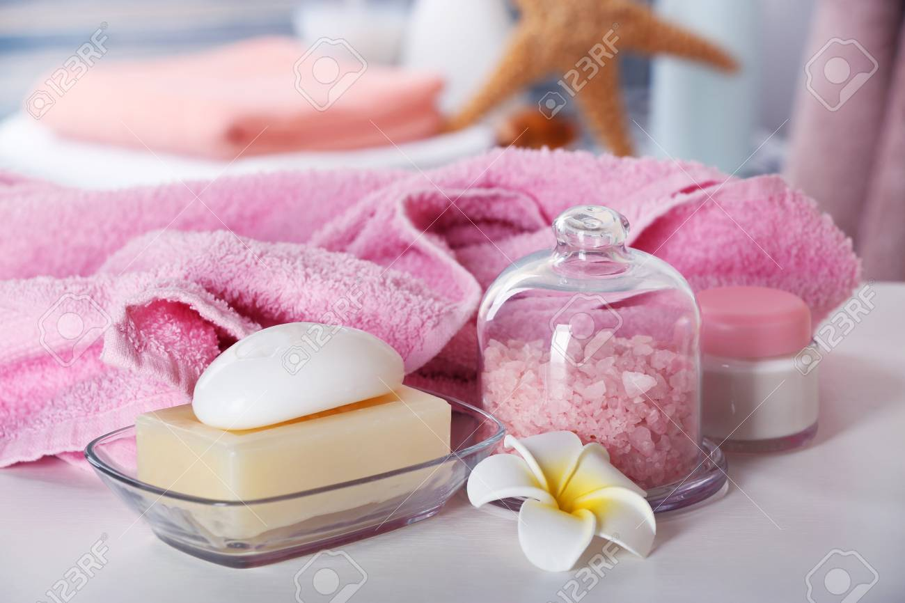 Pink Towel With Salt And Soap On Bathroom Table Stock Photo, Picture ...