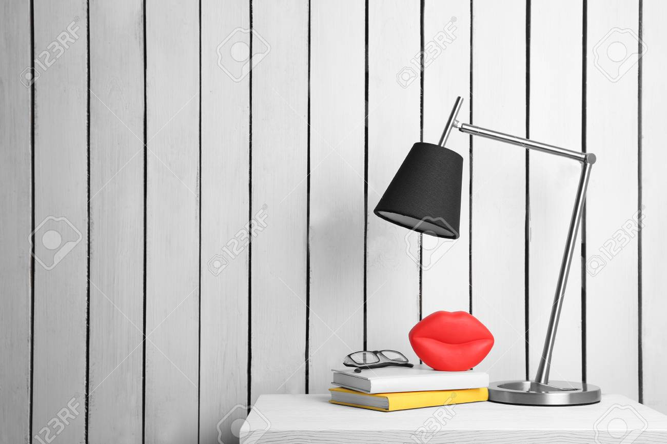 Lamp And Home Decor On The Locker On Wall Background Stock Photo