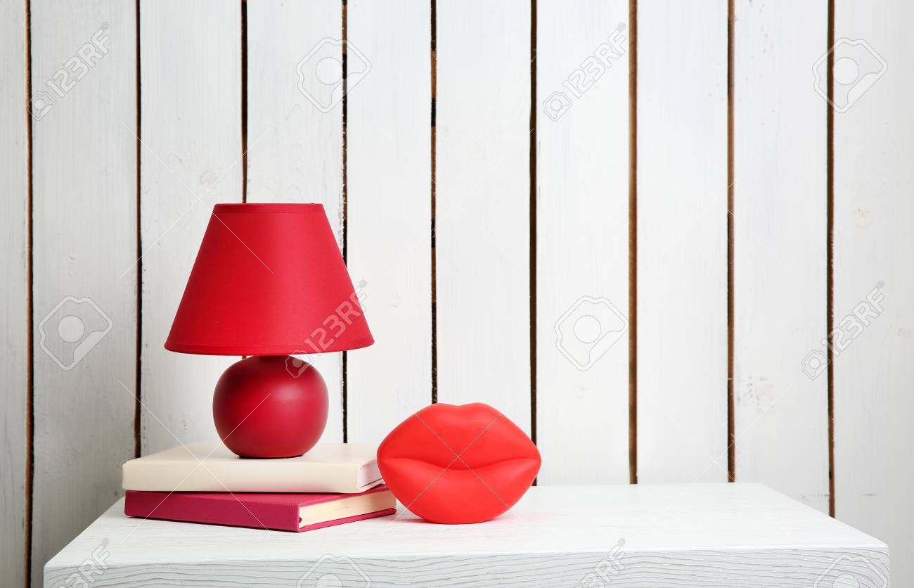 Night Lamp And Home Decor On The Locker On Wall Background