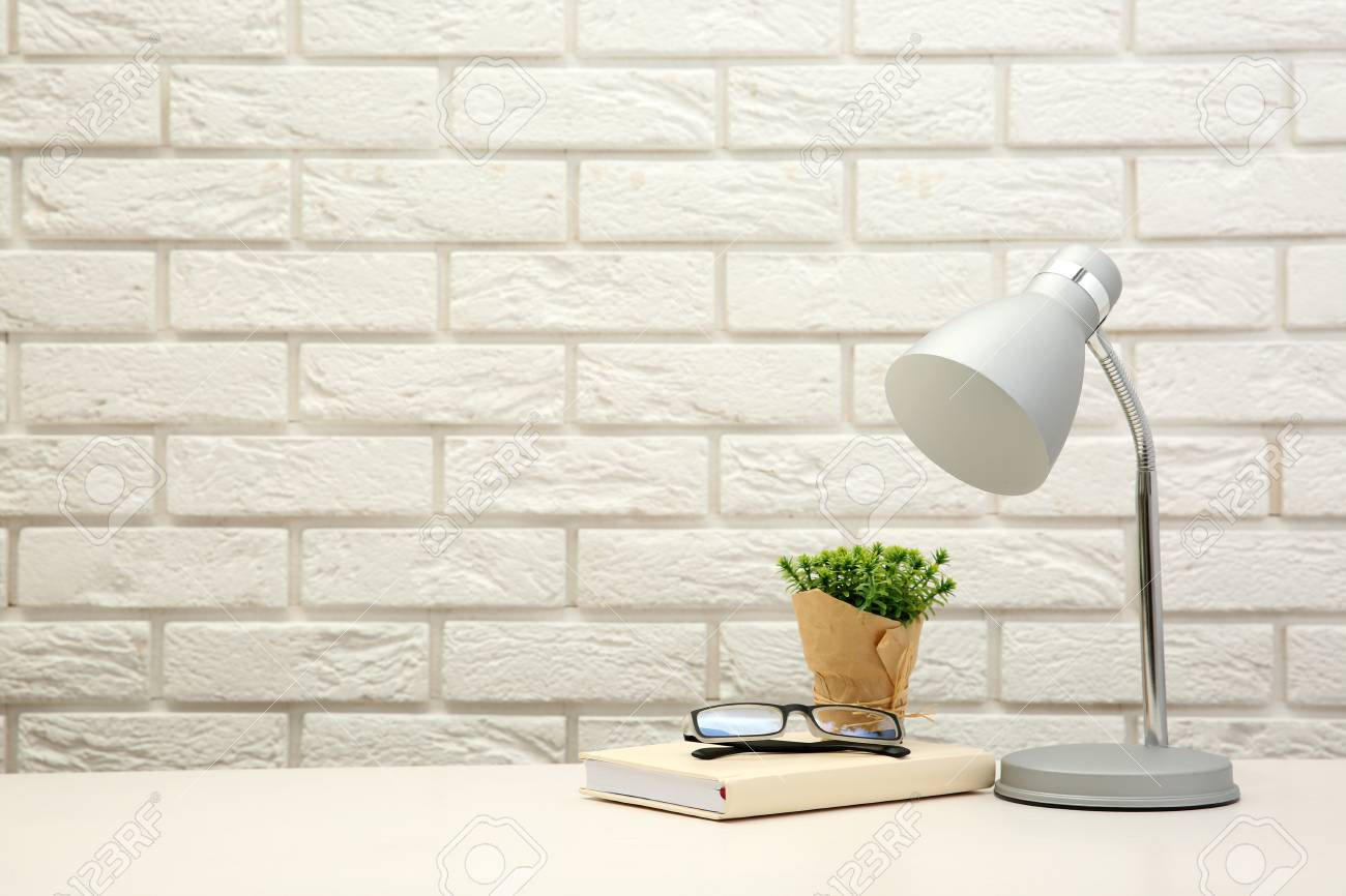 Lamp And Home Decor On Brick Wall Background