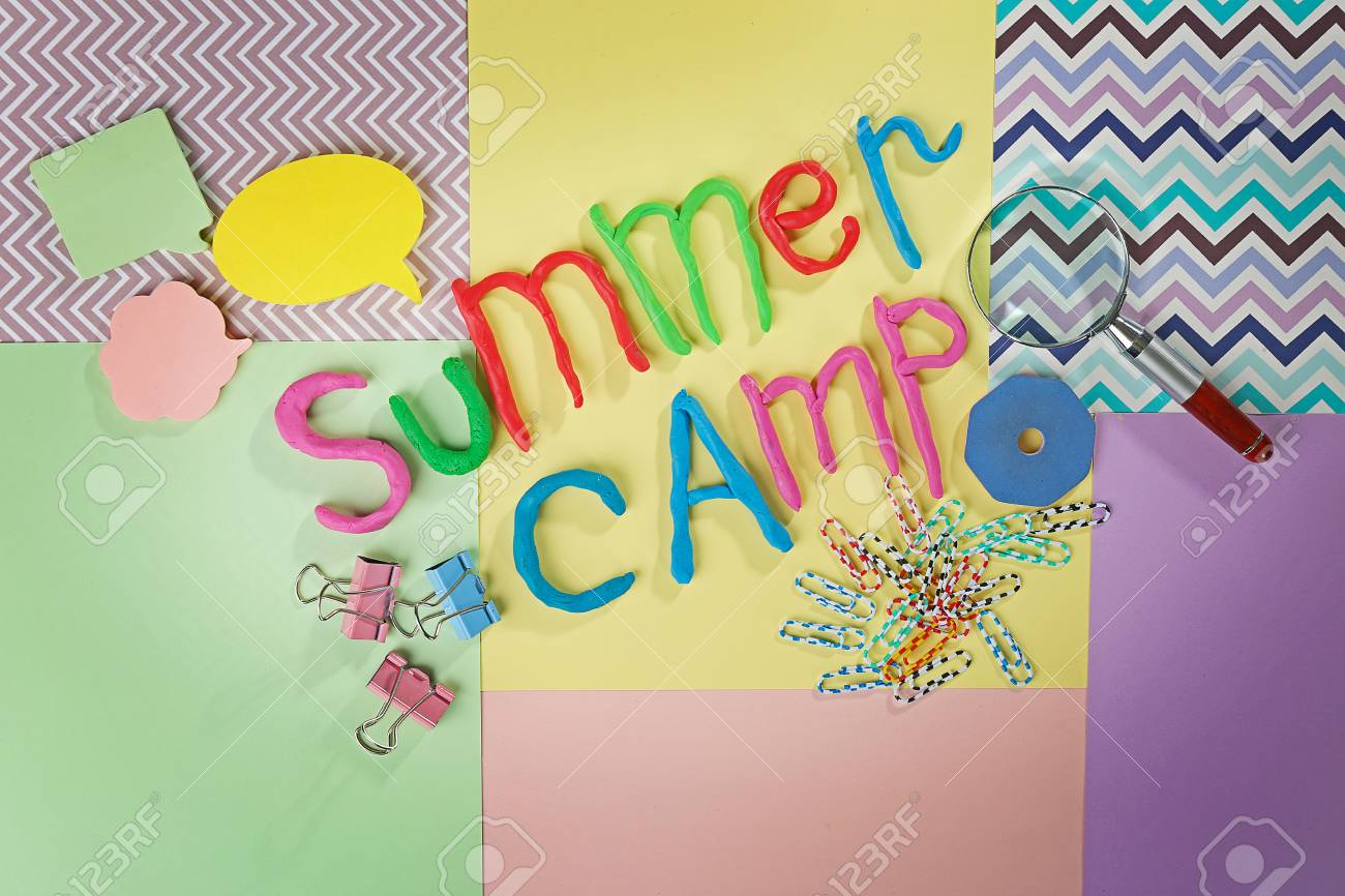 inscription summer camp made of colorful plasticine and stationery