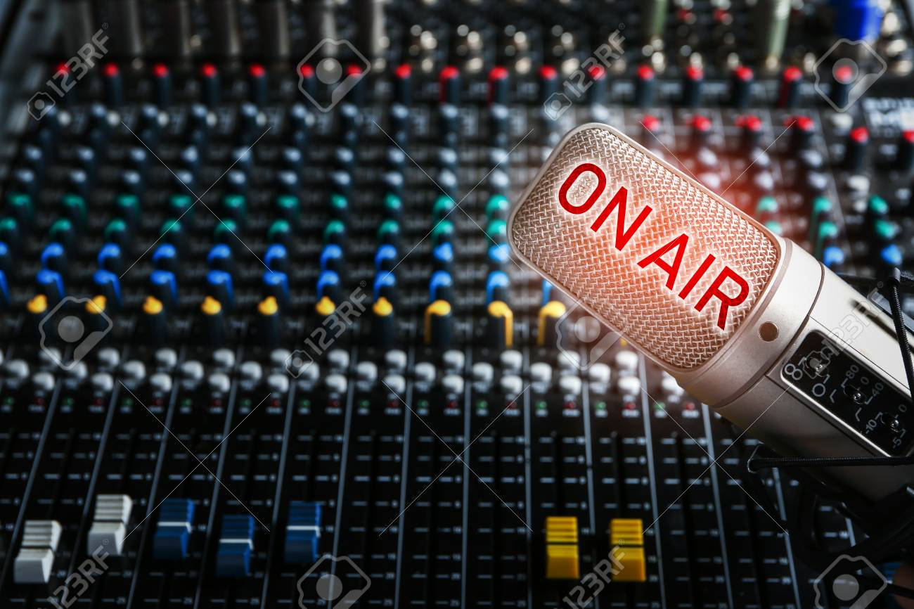 Microphone and mixer for live radio broadcast at modern studio - 95902053