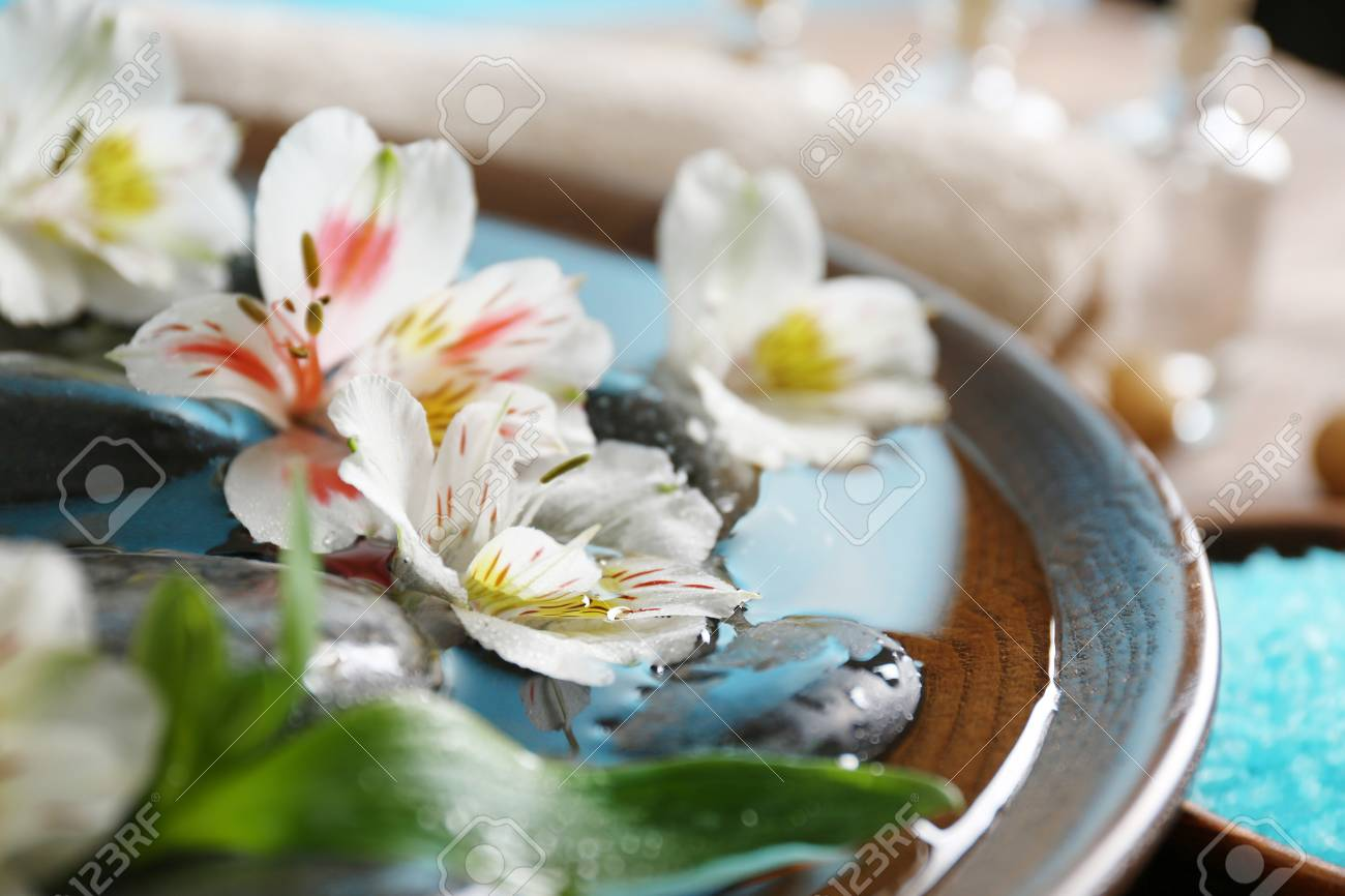 Beautiful exotic flowers and spa composition on the table close beautiful exotic flowers and spa composition on the table close up stock photo 95918470 izmirmasajfo