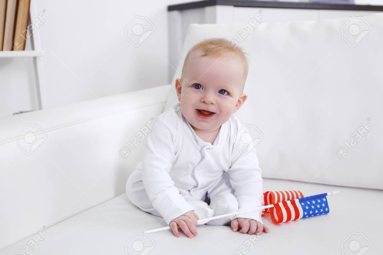 Cool Cute Baby Boy On White Couch With American Flag Closeup Dailytribune Chair Design For Home Dailytribuneorg