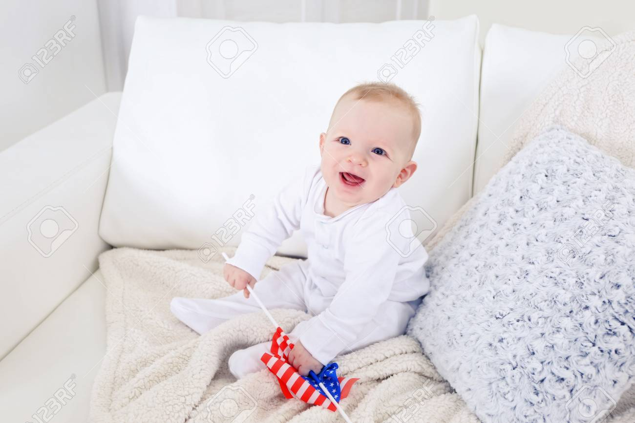 Marvelous Cute Baby Boy On White Couch With American Flag Closeup Dailytribune Chair Design For Home Dailytribuneorg