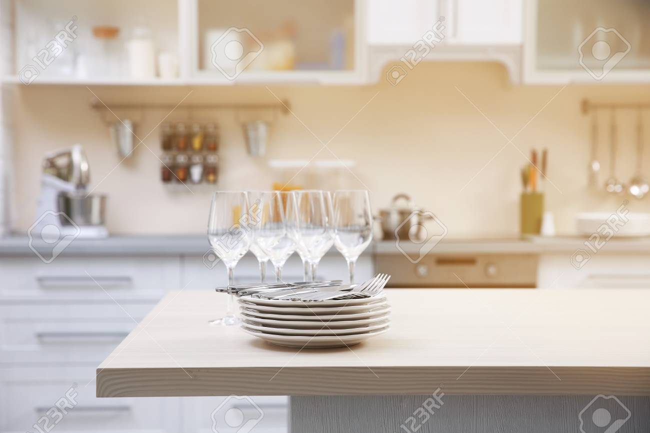 Prepared Clean Dishes For Dinner Party On A Table In The Kitchen ...