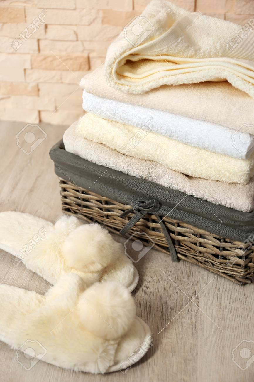 Bath towels in wicker basket and slippers Stock Photo - 95674092 388373192