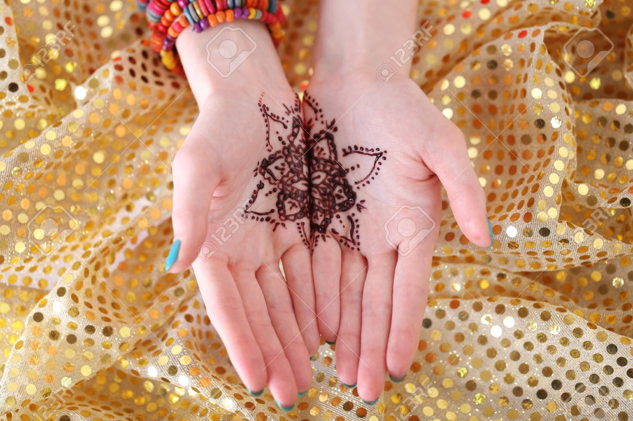 Henna Tattoo On Female Hands Top View Stock Photo Picture And