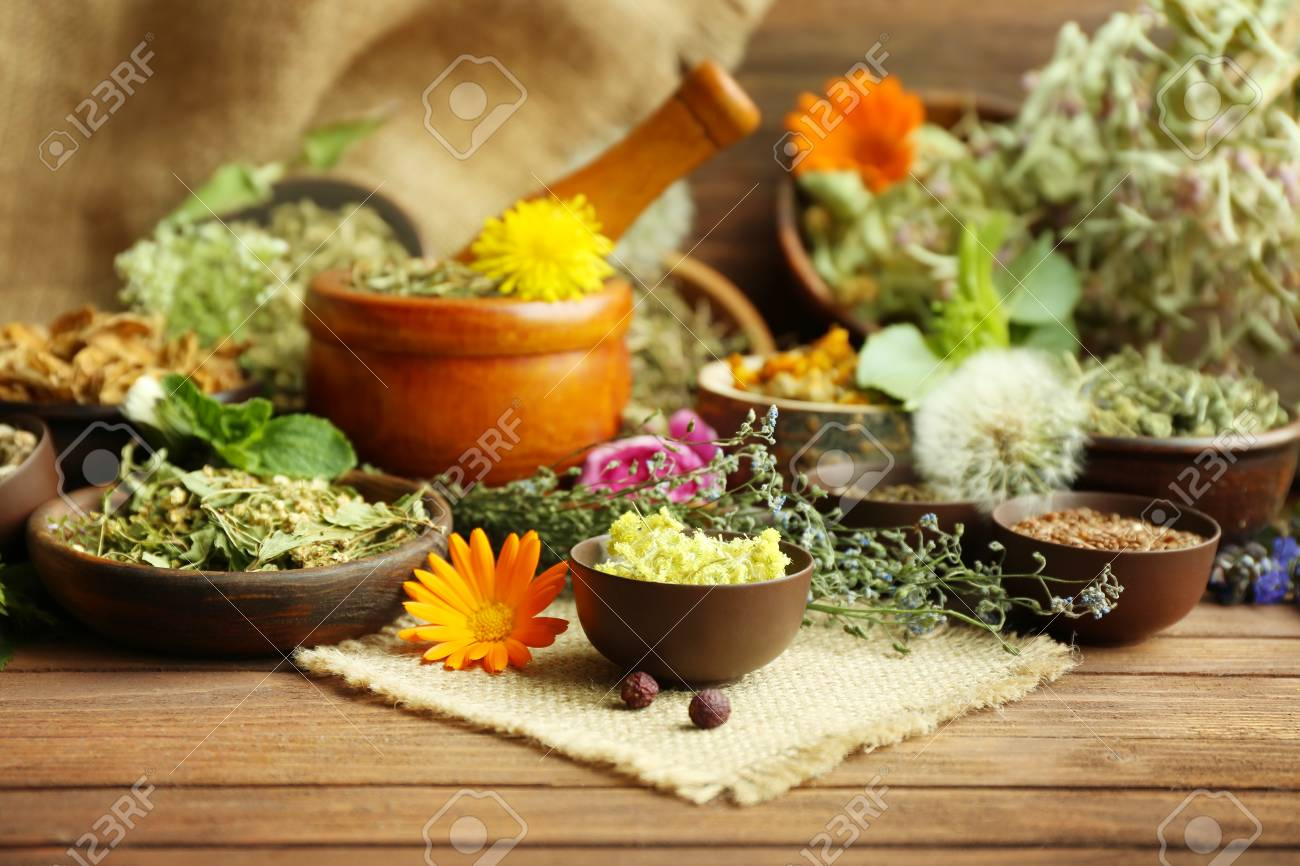 Herb selection used in herbal medicine in bowls on wooden table - 96016202