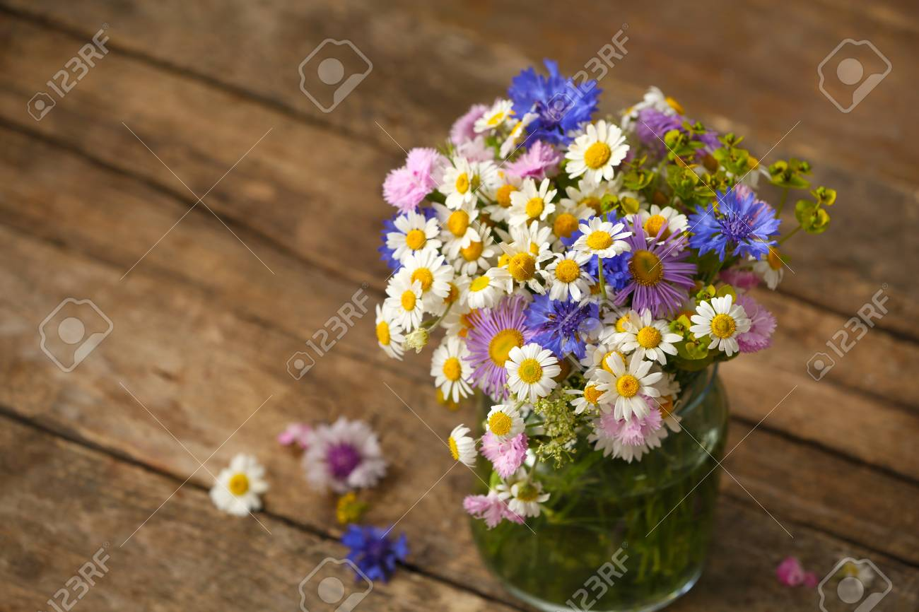 Wildflower Bouquet On Wooden Table Stock Photo Picture And Royalty Free Image Image 96040996