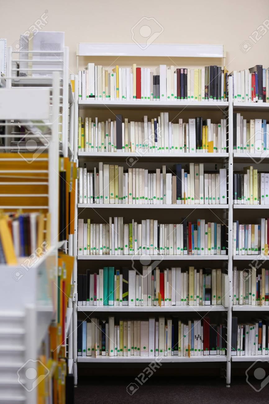 Modern Library Bookshelves Full Of Books Stock Photo Picture And