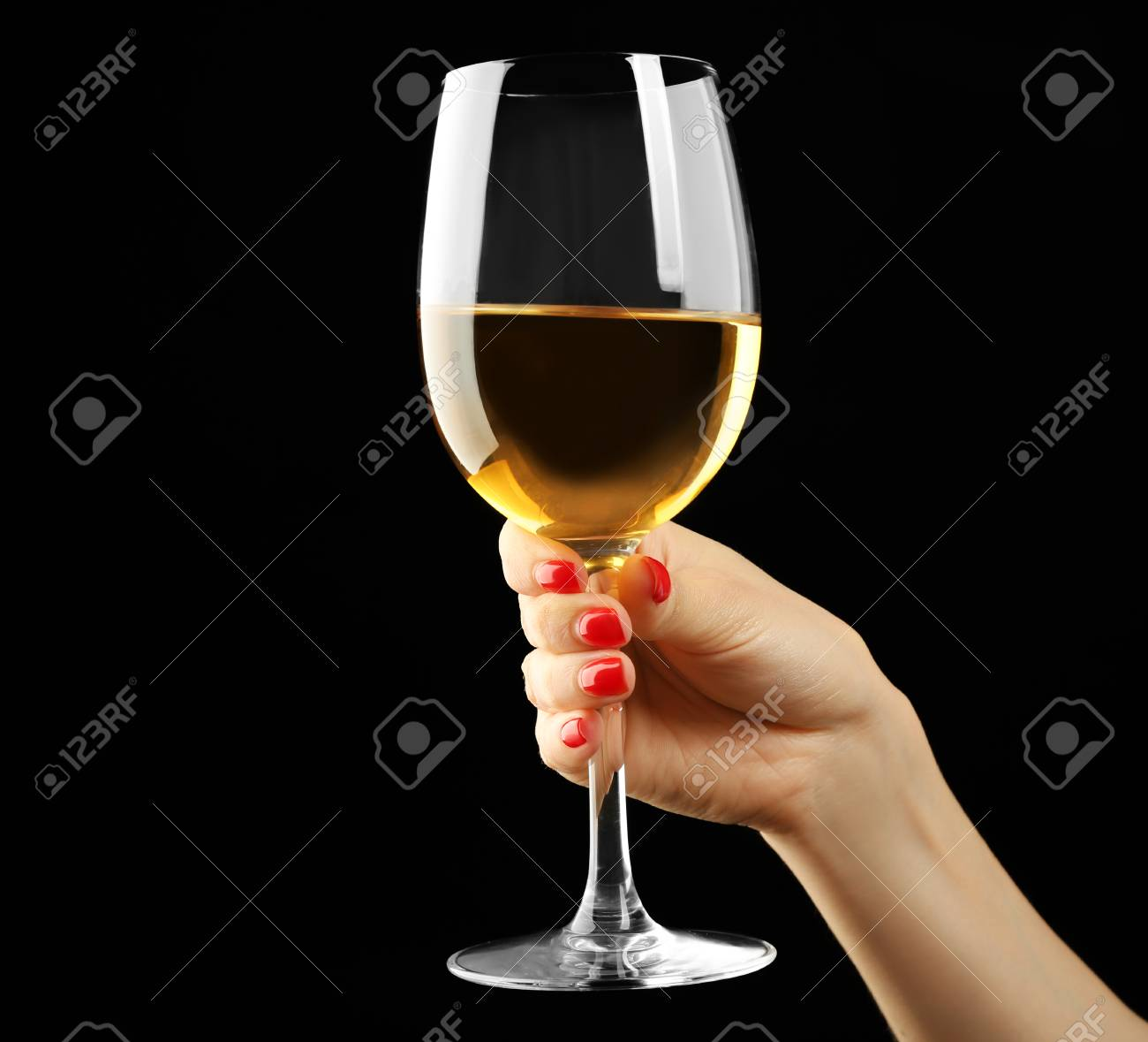 61db769402c2 Female hand holding glass of wine on black background Stock Photo - 96039431