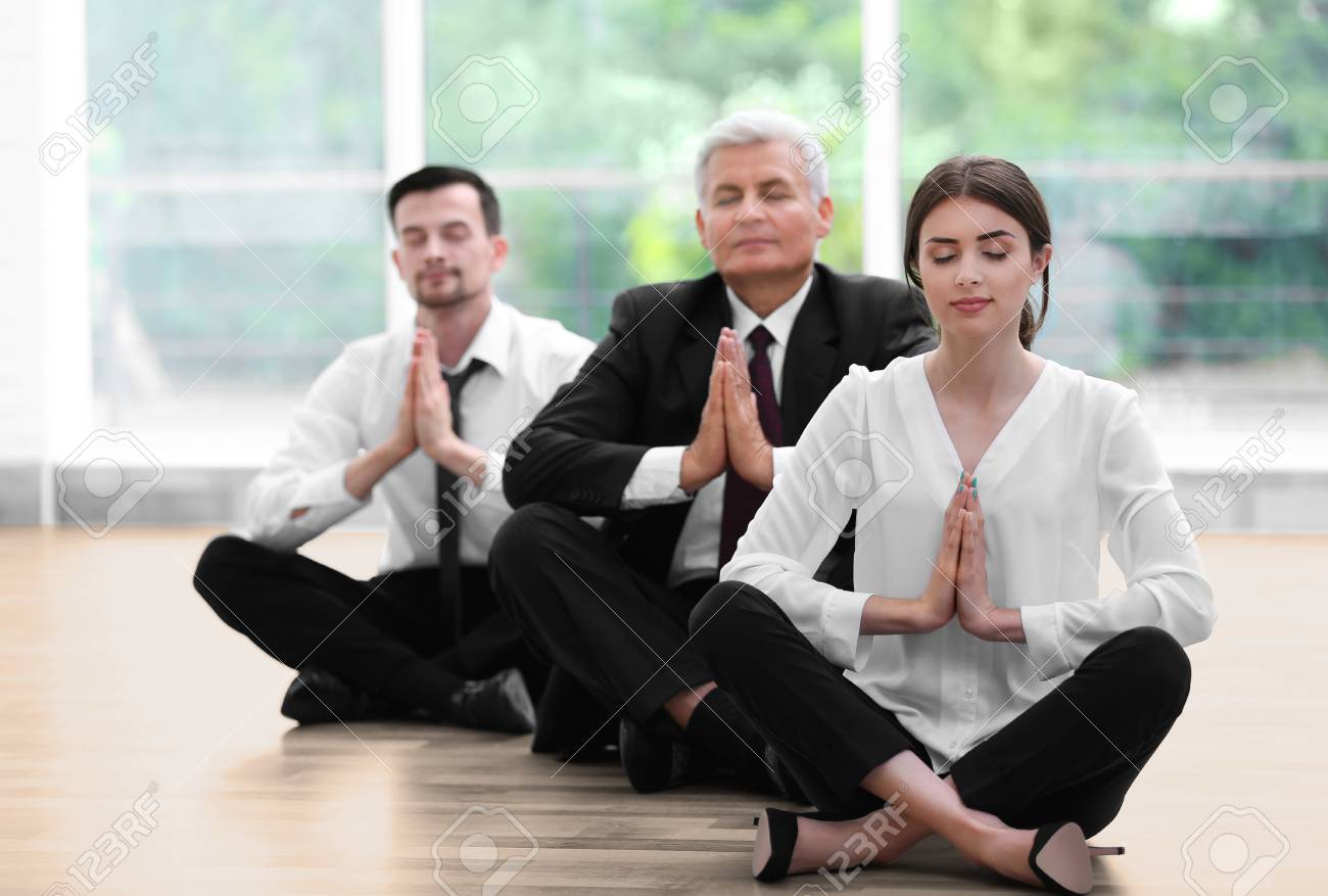 meditation office. Business People Relaxing In Meditation Pose Office Stock Photo - 96074805 E