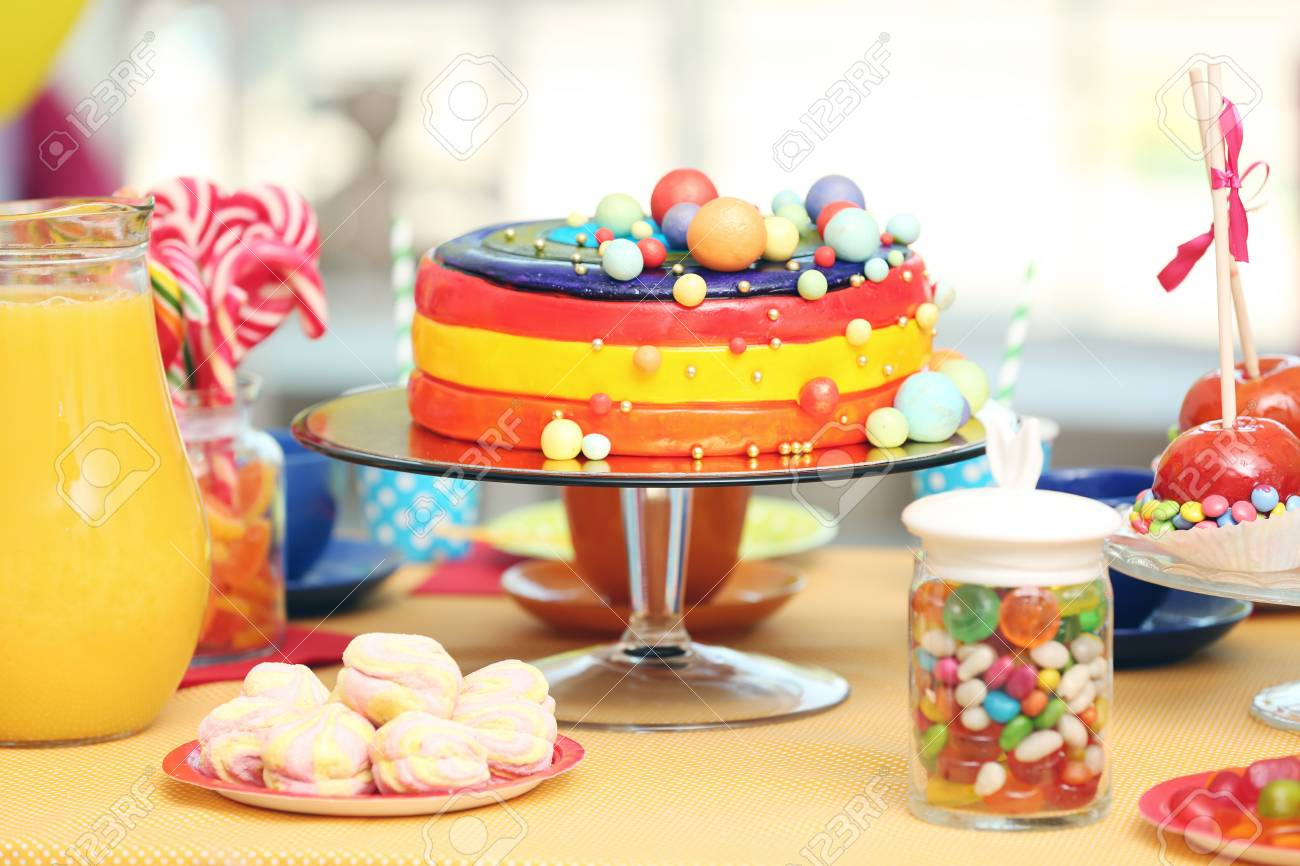 Tasty Birthday Cake And Sweets On Table At Party Stock Photo