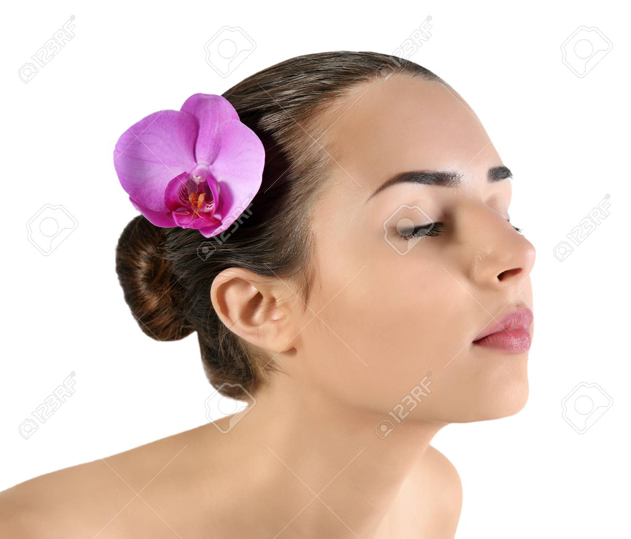 Portrait Of Young Attractive Woman With Exotic Flower In Hair