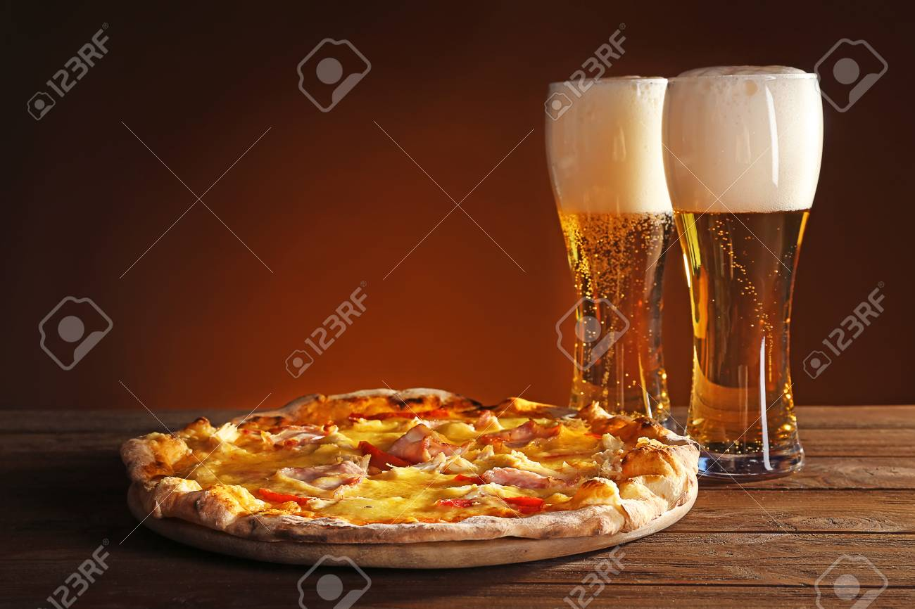 Tasty pizza with beer on wooden table - 96801799
