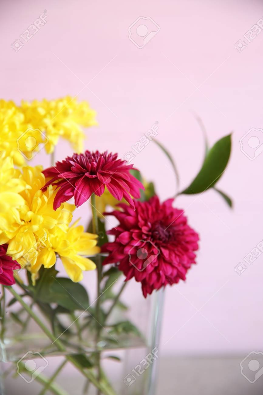 Glass Vase With Bouquet Of Beautiful Flowers On Color Background ...