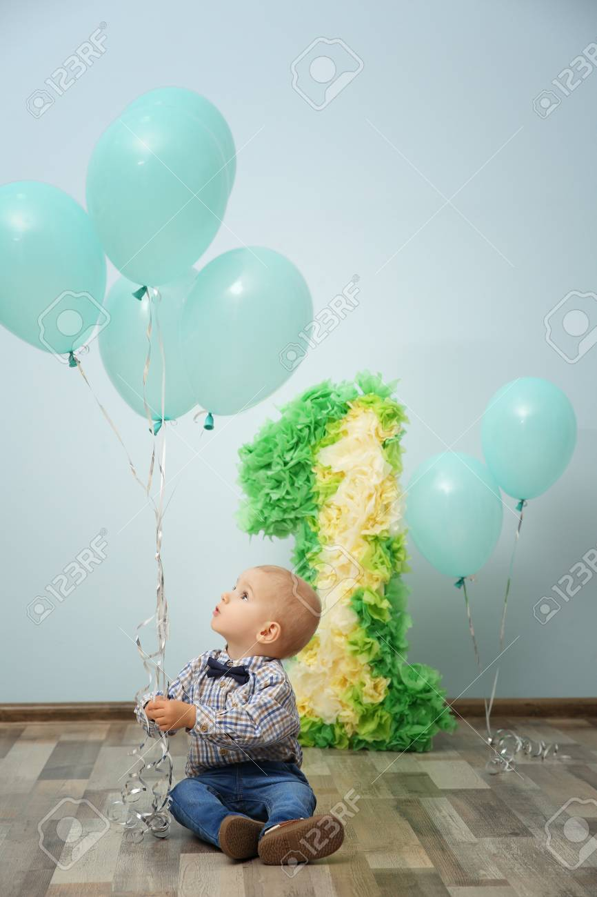 Cute Baby Boy With Birthday Decor Stock Photo