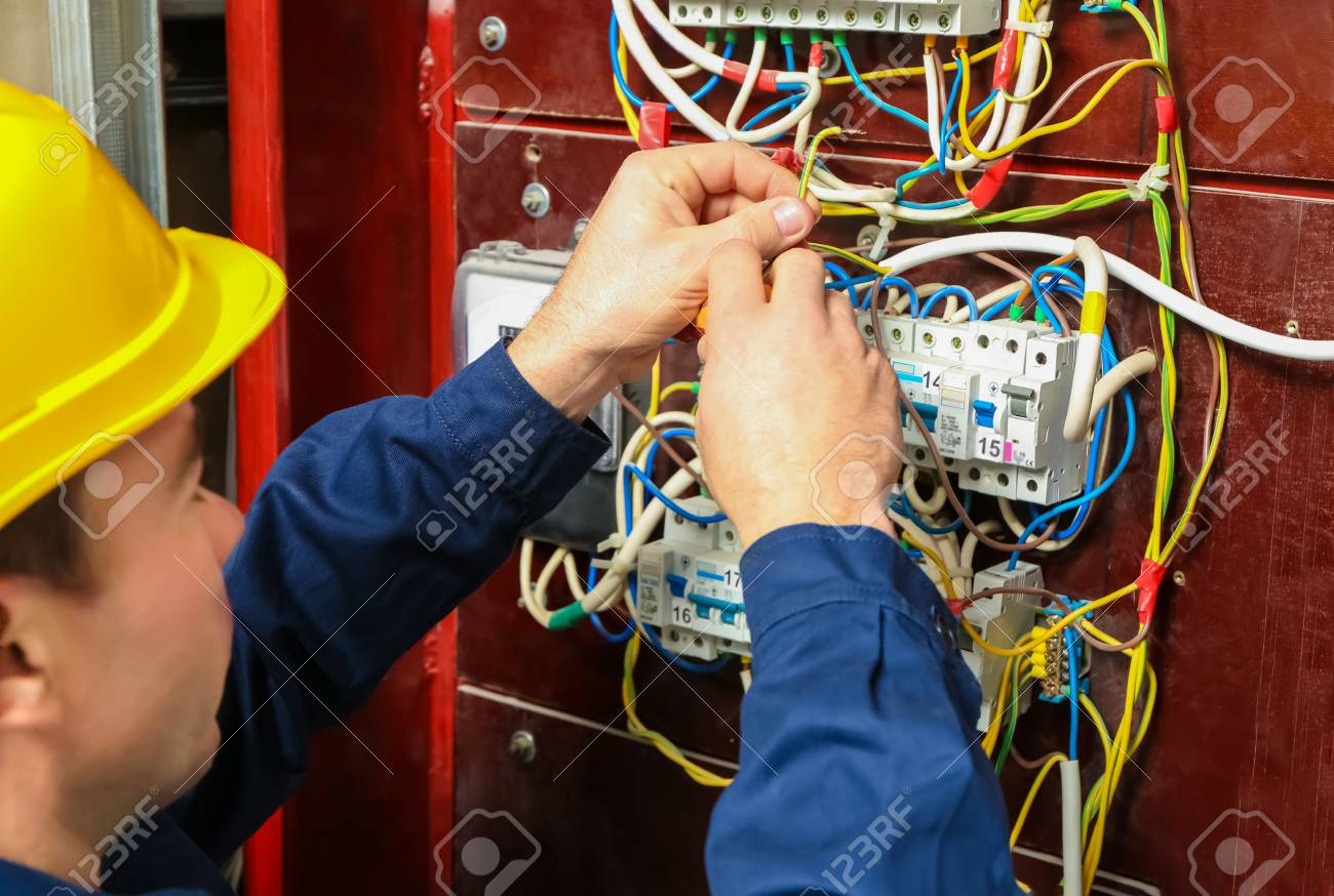 Electrician Connecting Wires In Distribution Board Stock Photo Fuse Wiring 98539692