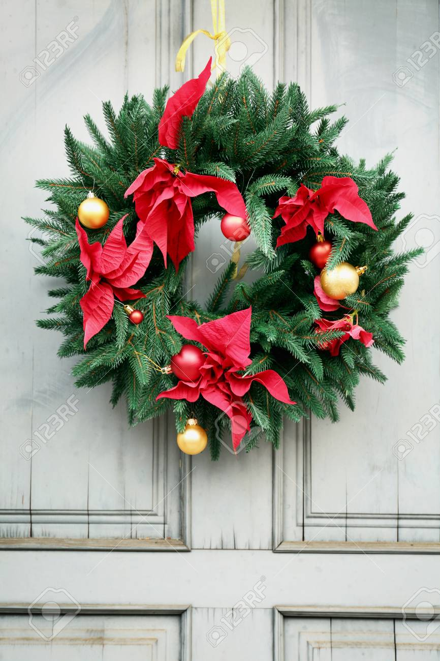 Beautiful Christmas Wreath Hanging On Door Stock Photo Picture And