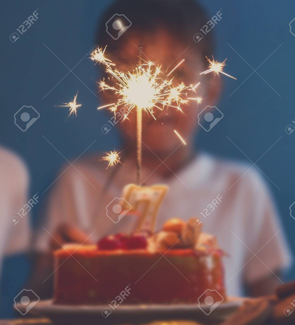 Cute Little Twins Blowing Out Sparkler On Birthday Cake At Party Stock Photo