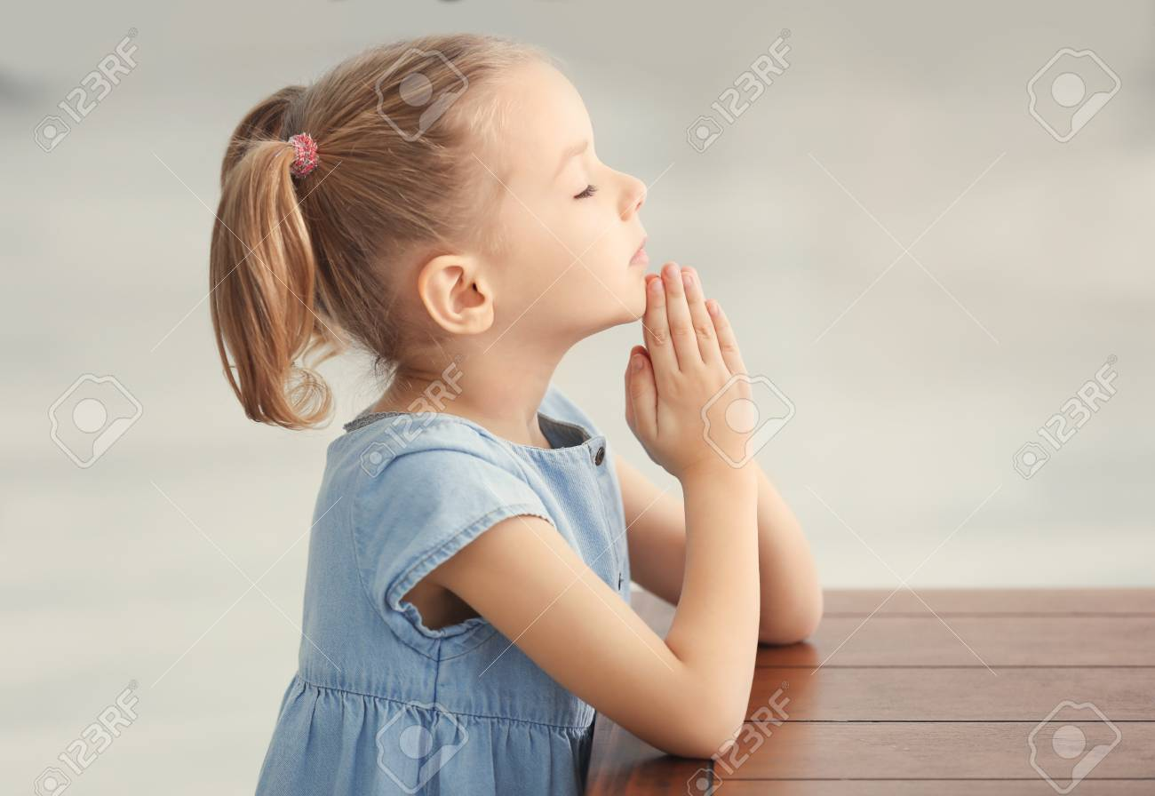 Cute Little Girl Praying At Home Stock Photo Picture And Royalty