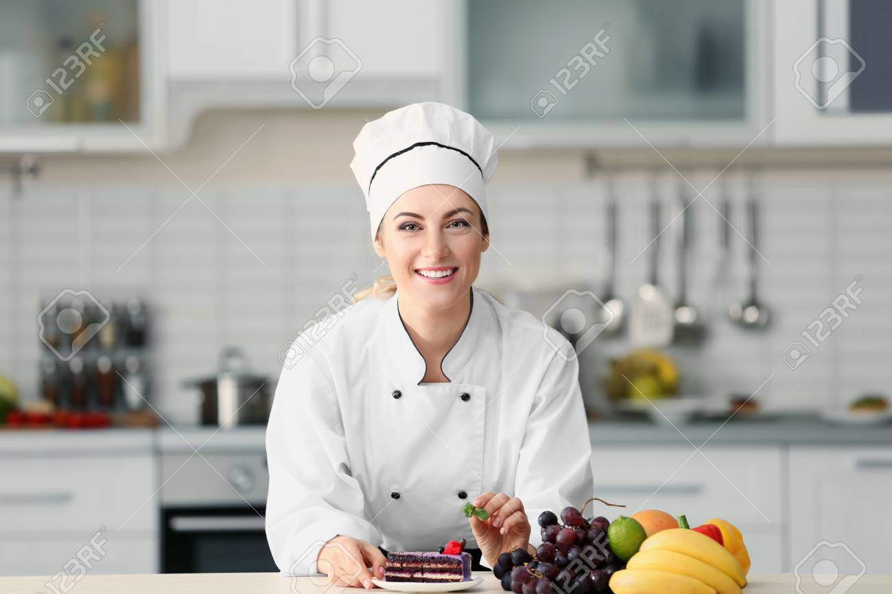 Female Chef Decorating Cake In Kitchen Stock Photo Picture And Royalty Free Image 97522151