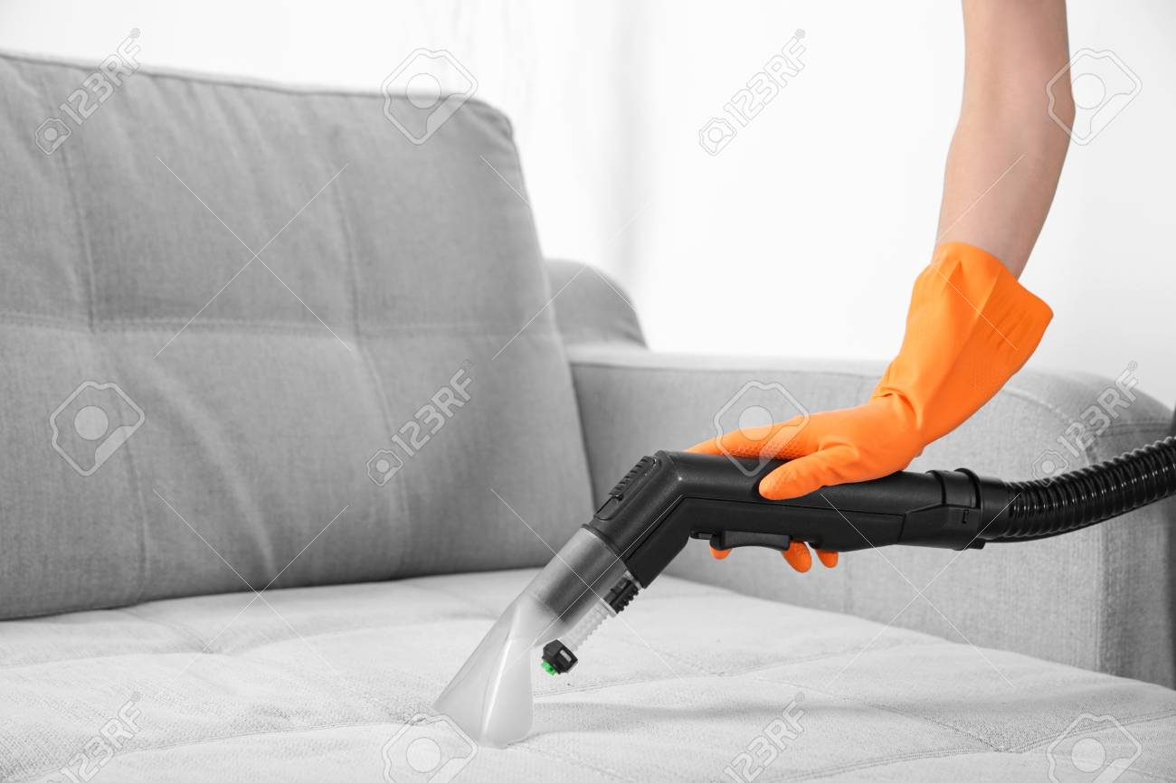 Good Stock Photo   Woman With Vacuum Cleaner Cleaning Couch