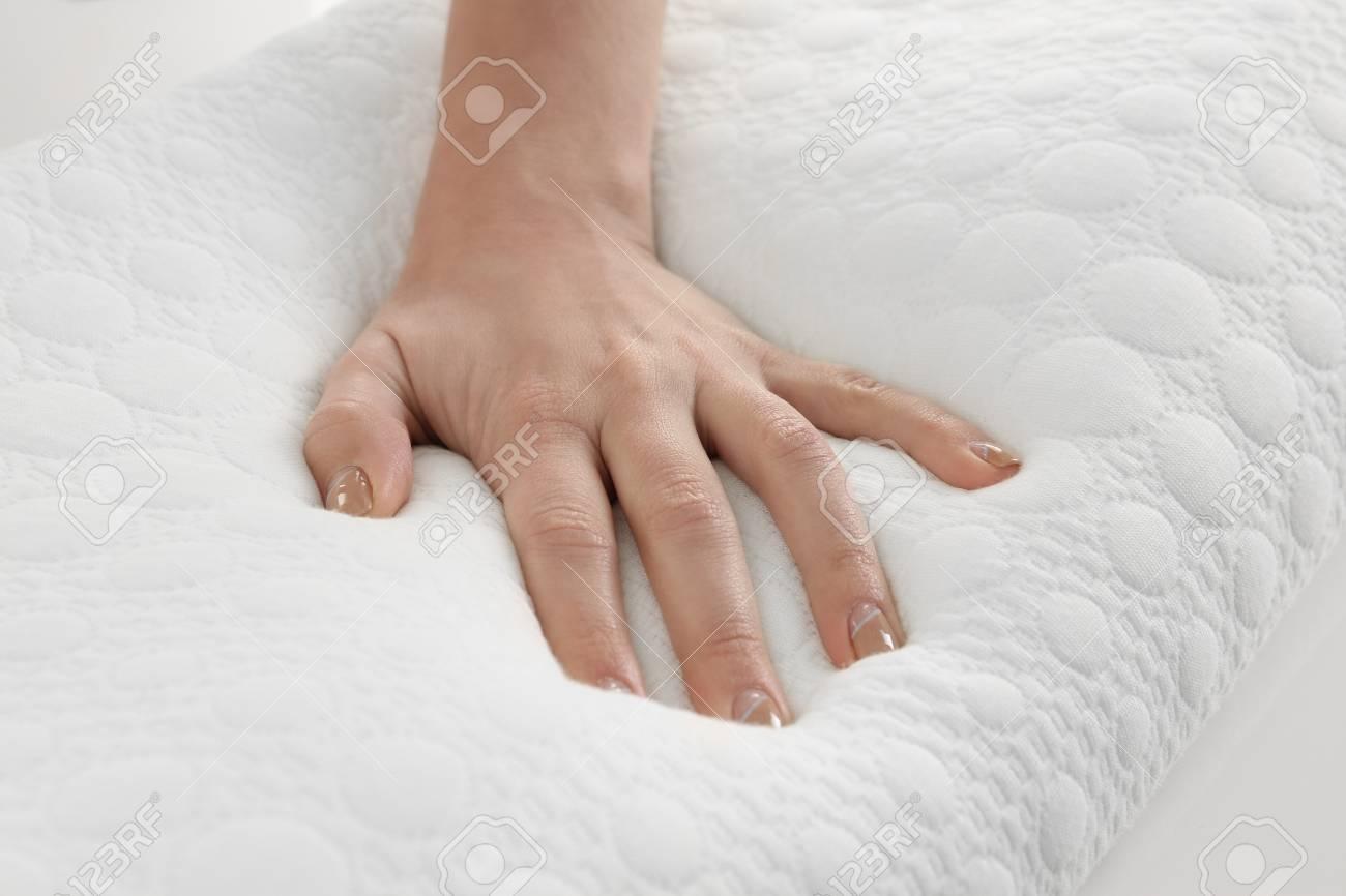 Female hand on orthopedic pillow, closeup - 97533495