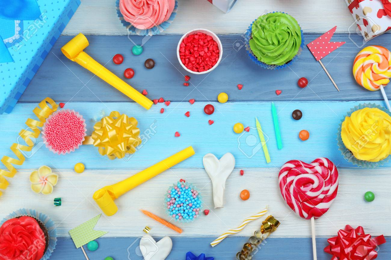 Bright Birthday Background With Sweets And Decorations Stock Photo