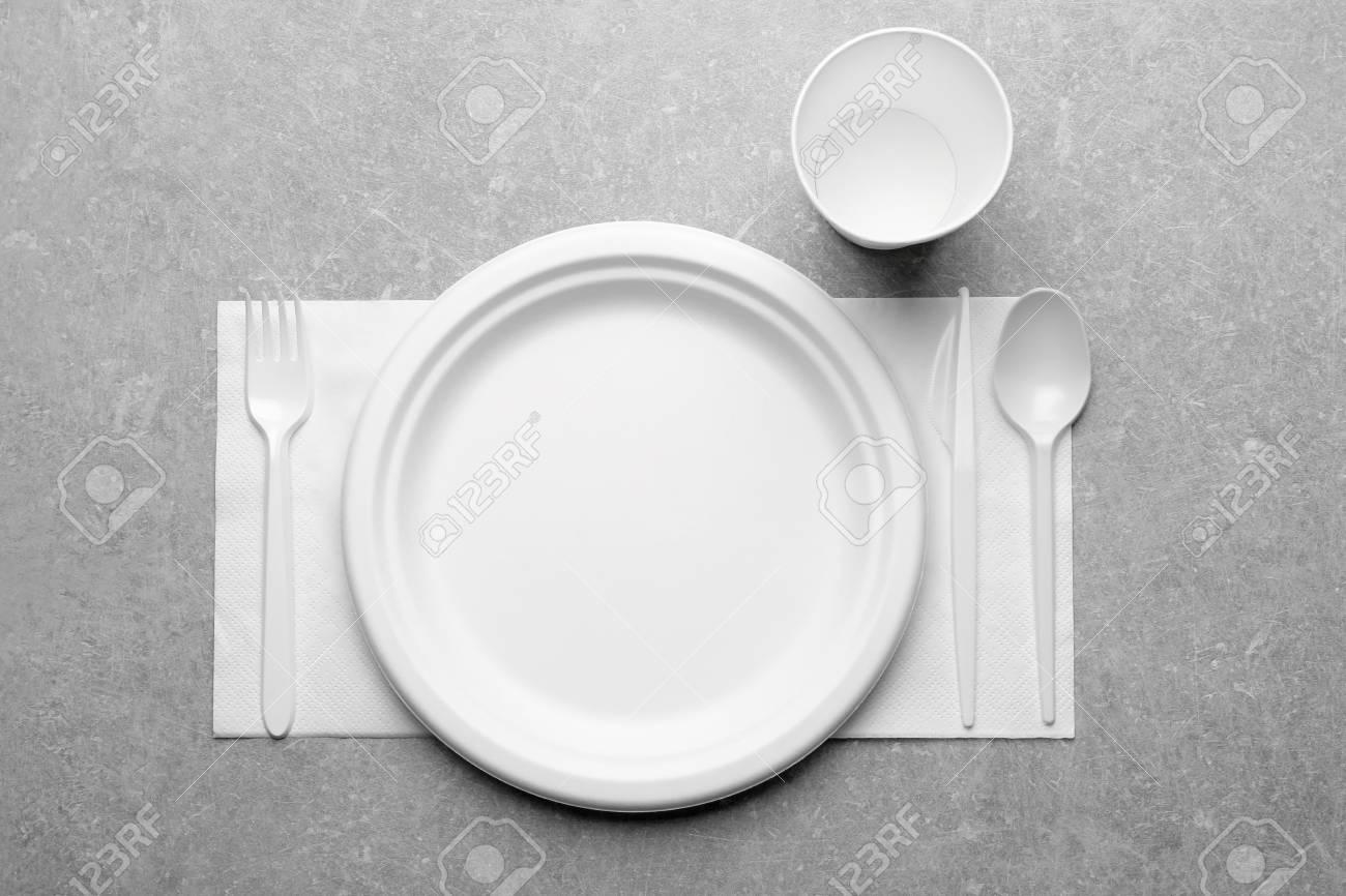 Stock Photo - White plastic disposable tableware on gray background & White Plastic Disposable Tableware On Gray Background Stock Photo ...