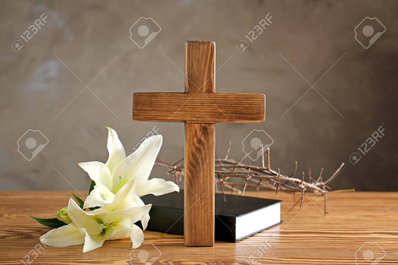 Crown of thorns, wooden cross and white lily on table - 97709620