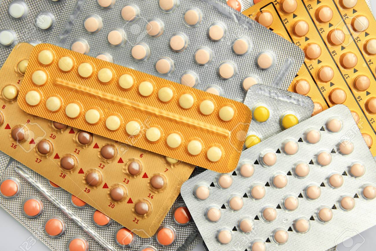 Strips of different oral contraceptive pills, closeup - 97887781