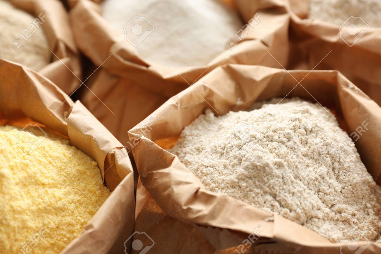 Paper Bags With Different Types Of Flour Closeup Stock Photo