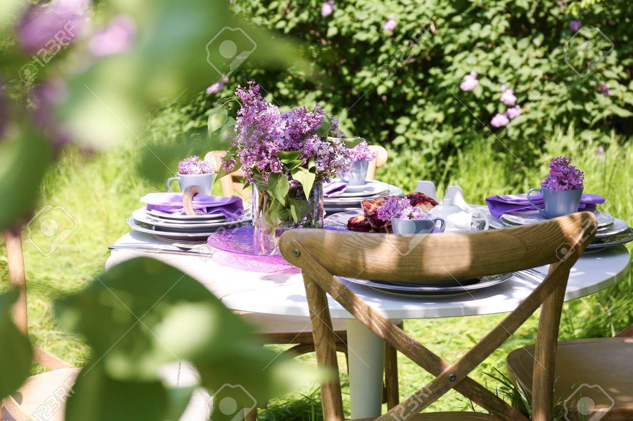 Beautiful table setting with lilac flowers decoration outdoors Stock Photo - 98015722 & Beautiful Table Setting With Lilac Flowers Decoration Outdoors Stock ...