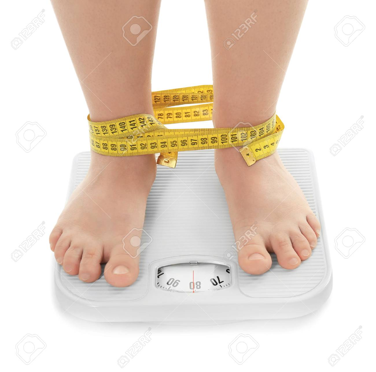 Overweight woman measuring her weight using scales, on white background. Diet concept - 98033503