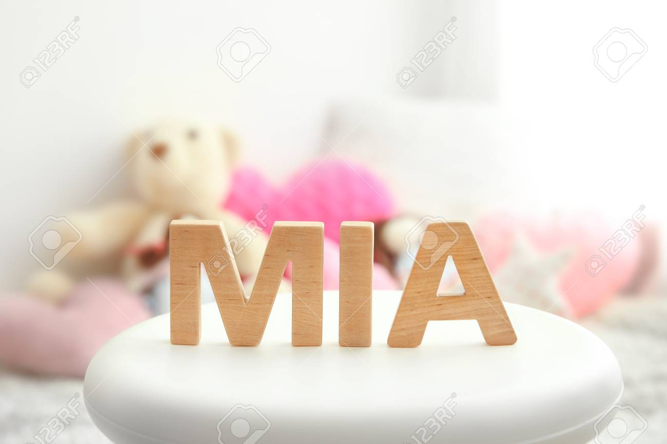 Strange Baby Name Mia Composed Of Wooden Letters On Stool Choosing Name Gmtry Best Dining Table And Chair Ideas Images Gmtryco