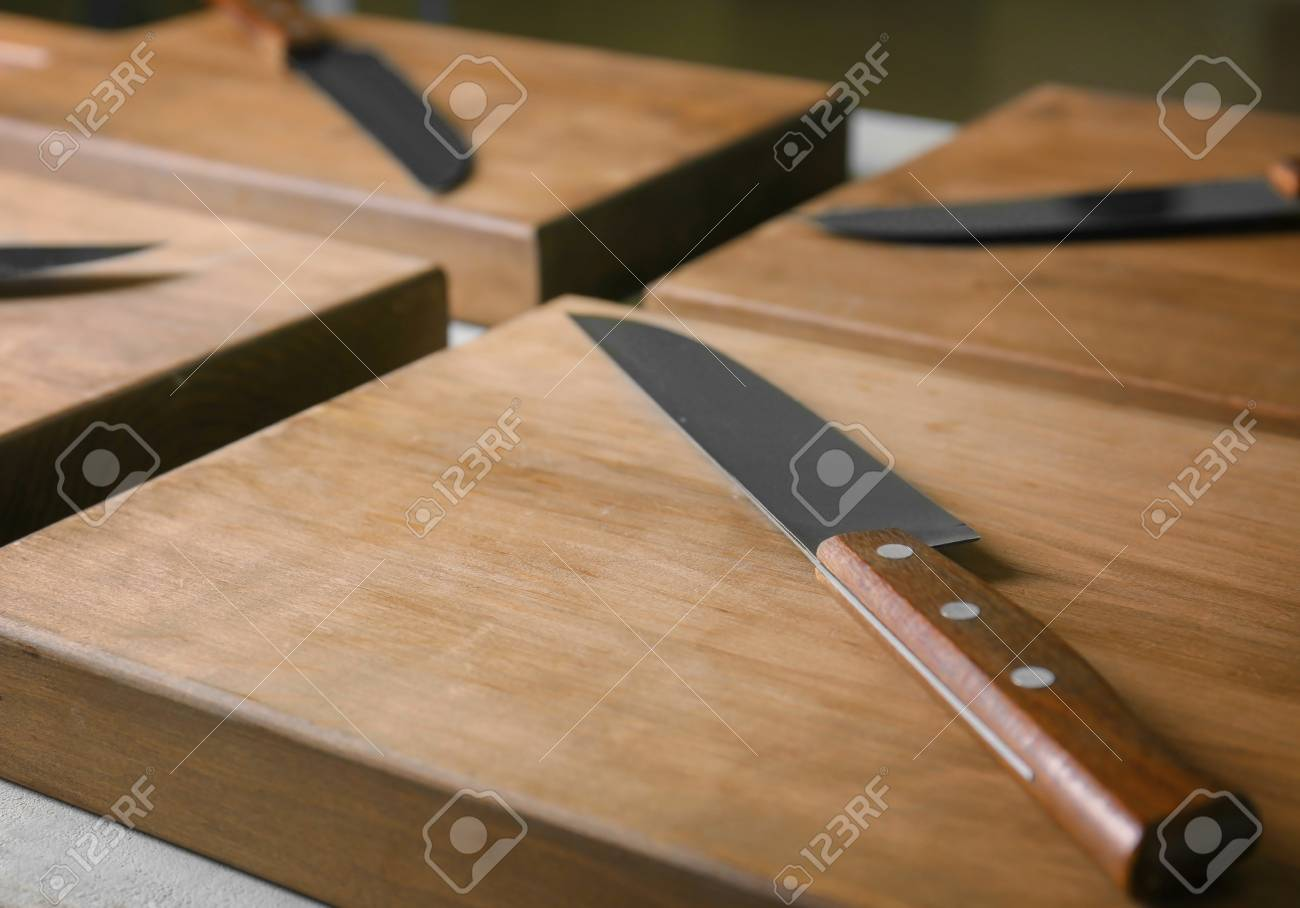 Knives And Wooden Boards On Kitchen Table. Cooking Classes Concept ...