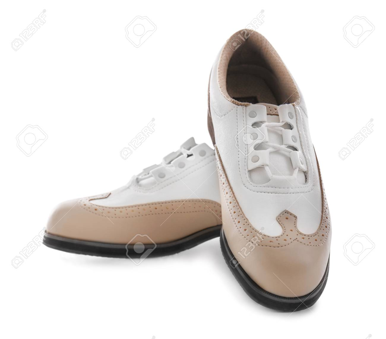 Pair Of Female Golf Shoes On White