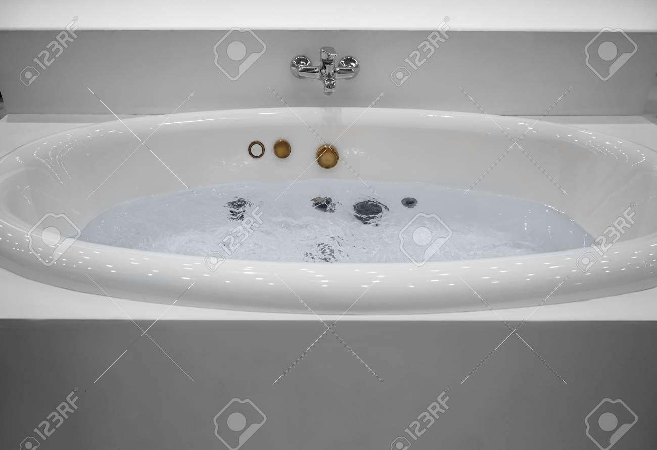 New Jacuzzi Bathtub Filled With Water In Store Stock Photo, Picture ...