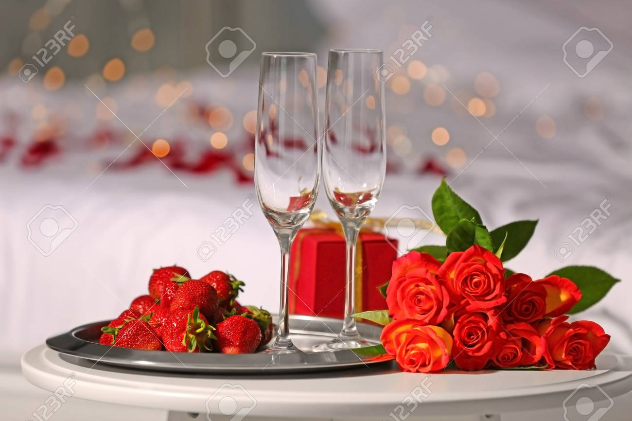 Romantic Composition With Strawberry And Red Roses On Table In Bedroom Honeymoon Concept Stock Photo