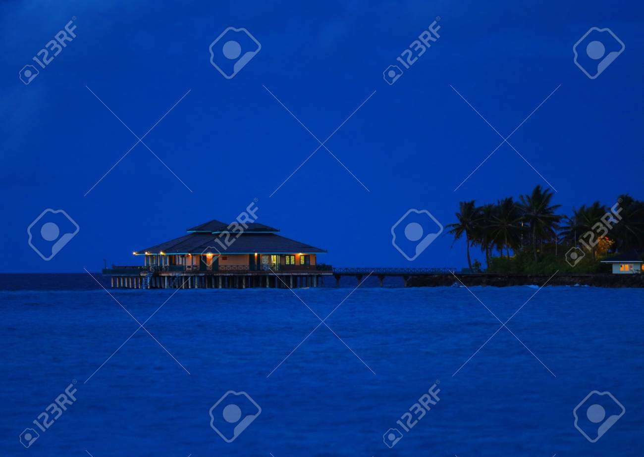 View Of Modern Beach House At Tropical Resort In Evening