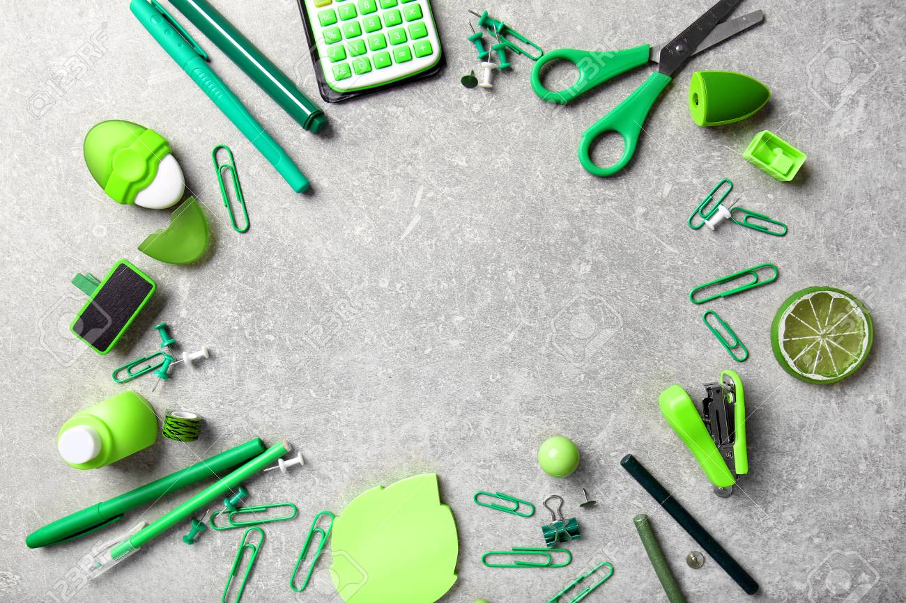 Frame Of Green Office Supplies On Grey Background Stock Photo   98142079