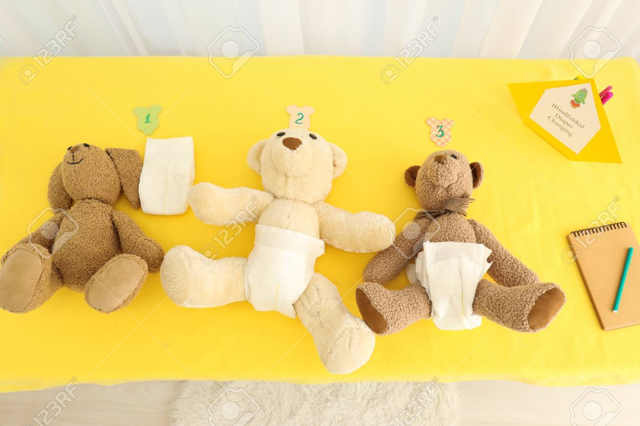 Soft Toys In Diapers On Table At Baby Shower Party Stock Photo ...